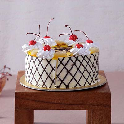 Pineapple Cake with Cherry & Cream Toppings