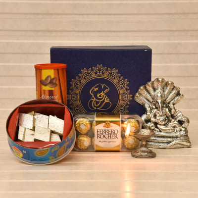 Sarp Ganesha Idol with Diya, Roasted Almonds, Chocolates & Kaju Katli