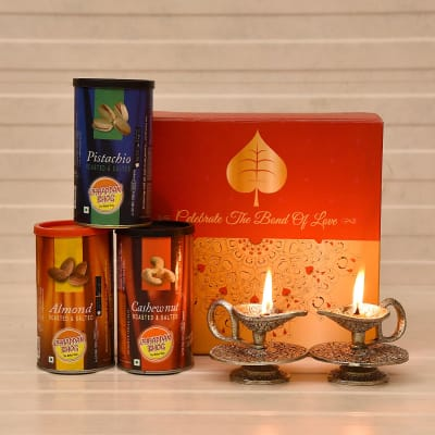 White Metallic Designer Diya Set with 3 Roasted Dryfruits Cans