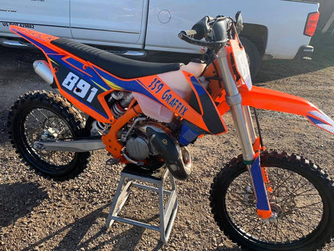Meredith Shockleys KTM SX150 with flo orange plastic and Stubbi gripper graphics