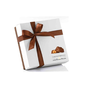 Individual wrapped chocolate with 4 whole hazelnuts in Giftbox with ribbon. 120 grams.