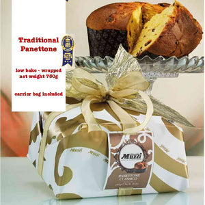 750-gram size of Muzzi's classic panettone wrapped in white and gold elegant paper wrapping and sealed with a gold ribbon