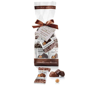 Four whole hazelnuts in milk chocolate. Individual wrapped. 150 gramss