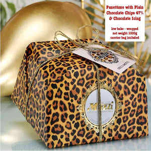 1kg Muzzi panettone with plain chocolate chips and chocolate icing handwrapped in a spotty leopard pattern