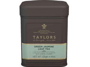 Green tea with Jasmine tea leaves in caddy