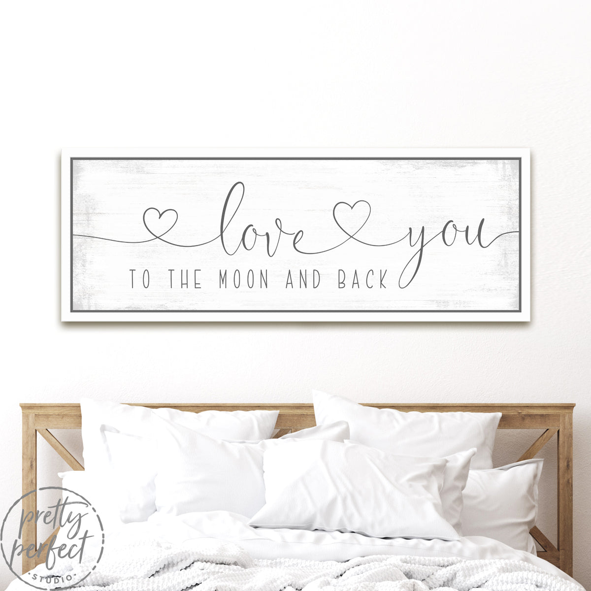 Love You to the Moon and Back Sign With Hearts Above Headboard - Pretty Perfect Studio