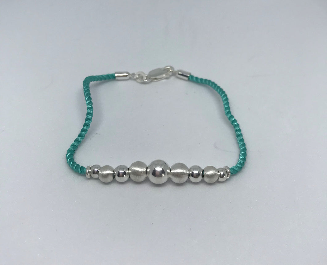 Sterling Silver Beaded Turquoise Silk Rope Bracelet