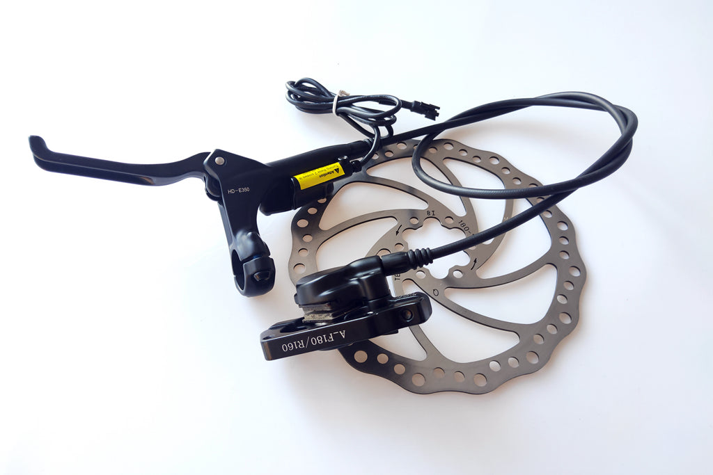 Electric Tektro hydraulic brake with brake disc 180mm