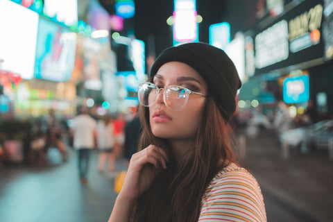 girl in blue light blocking glasses and beanie