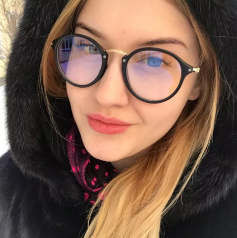 girl in hoody wearing blue light glasses