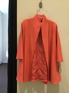 Swing coat in mango by Estelle and Finn