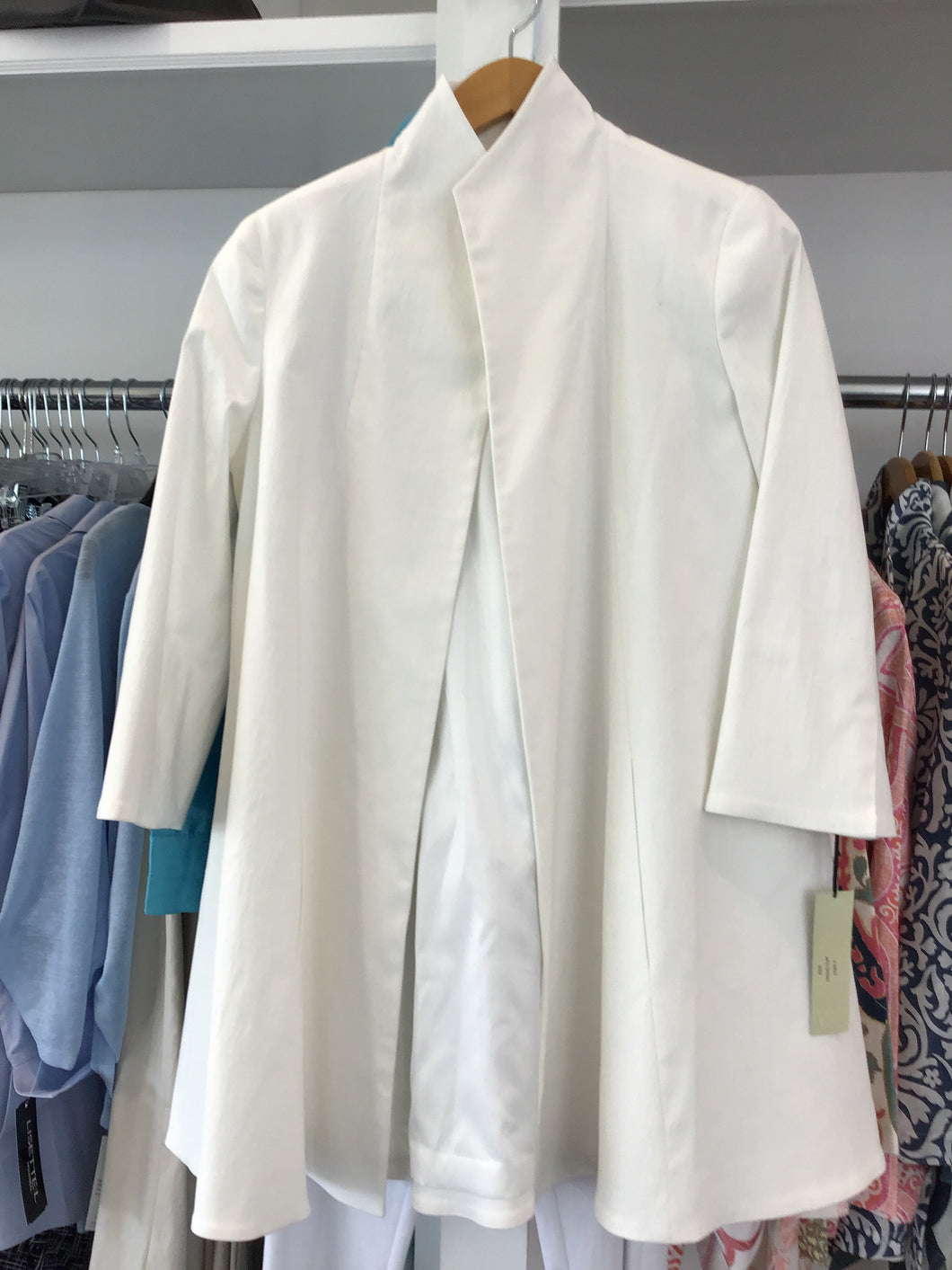 Swing coat in ivory by Estelle and Finn