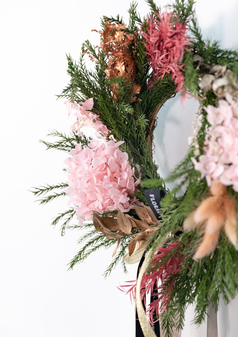 Fresh christmas foliage and preserved flower decor wreath by singapore florist