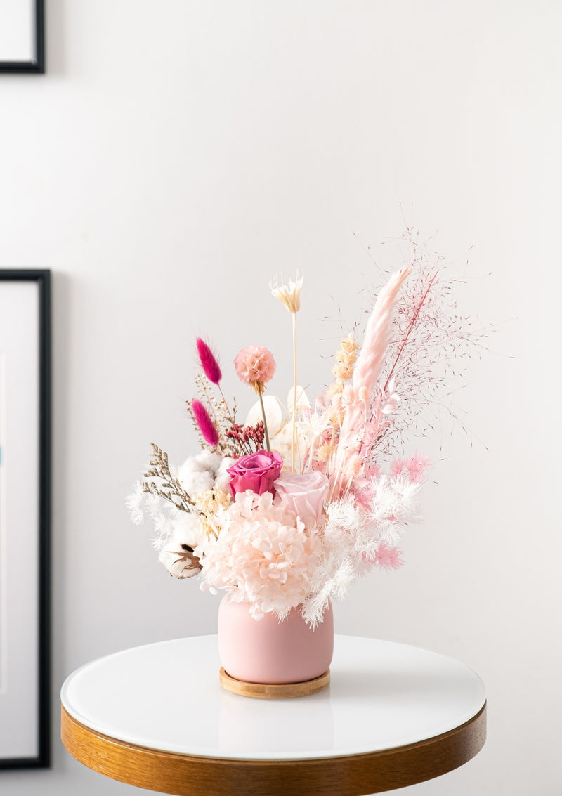 Shades of beautiful and dainty pink and white preserved flowers designed in a vase arrangement by singapore florist