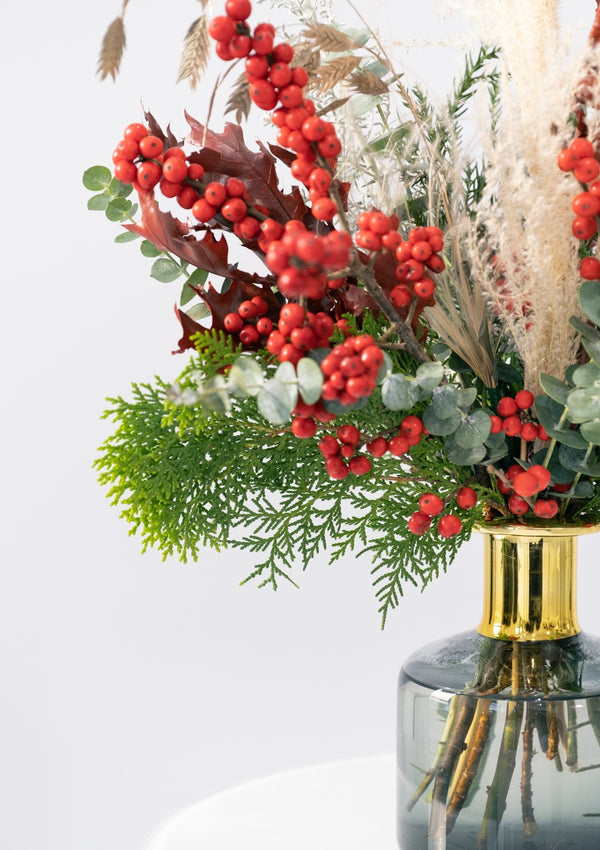 Fresh red holly berries christmas flower vase arrangement designed by singapore florist floral mikelle