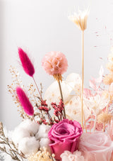 With a touch of bold pinks this love oasis designed by singapore florist is filled with premium preserved flowers and airdried blooms