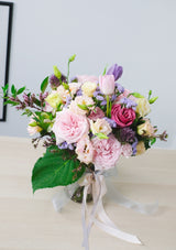 Sweet and romantic pink and lilac fresh flower roses in a vase flower arrangement by singapore best florist floral mikelle specialising in preserved flowers