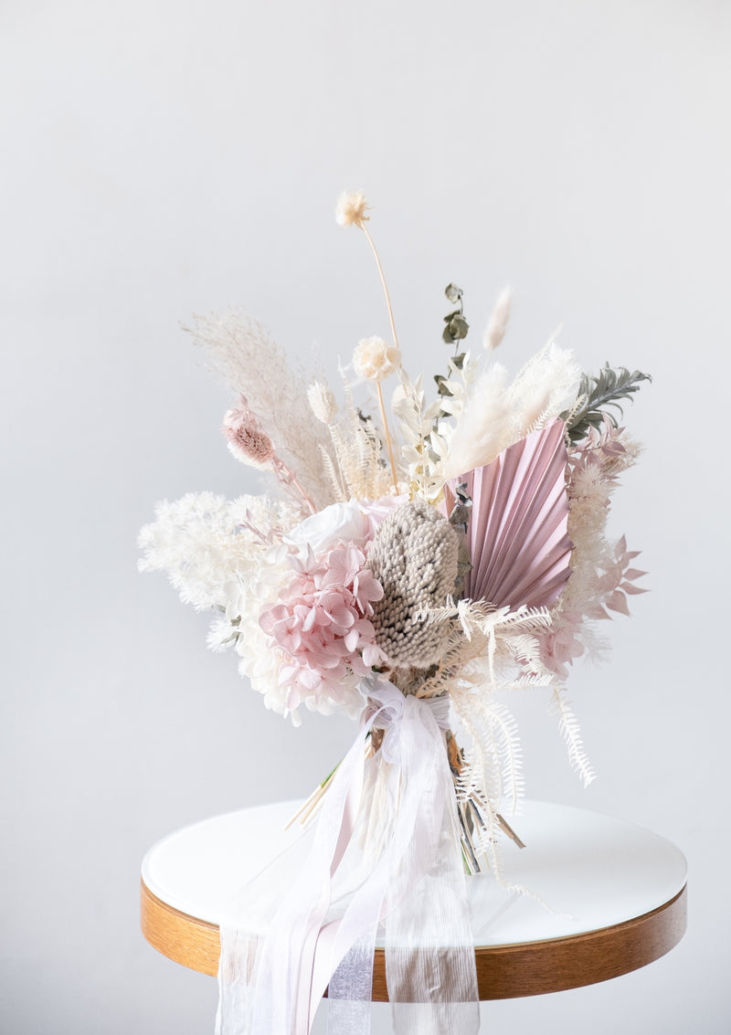 All rounded small bridal bouquet lovely for small and intimate wedding and pre-wedding shoots in singapore