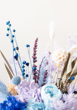 These blues and purples are the calm to the heart and soul preserved flower vase arrangement inspired of the light grace filled summer breeze