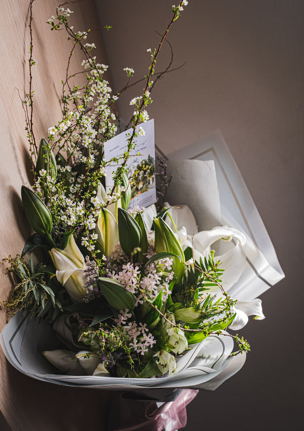 Grand and classy lilies with a touch of pinks for the most beautiful lady a floral design curated by singapore best florist for preserved flower arrangements and customised flower bar events