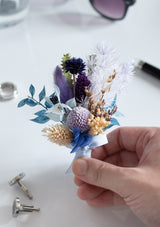 Elegant blues and purple groom's boutonniere for wedding day in singapore with free delivery