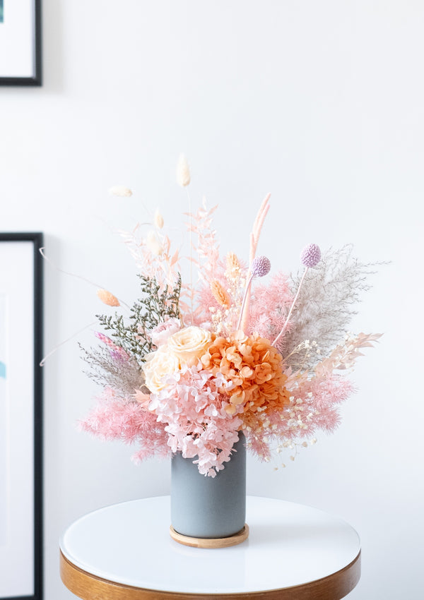 This soft and gentle love filled colors preserved flower arrangement designed by top florist in singapore for floral designing