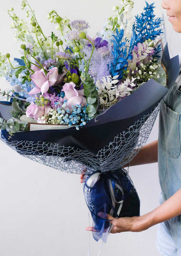 A huge blue theme fresh flower and preserved flower bouquet for a proposal in singapore floral design by top preserved flower florist floral mikelle