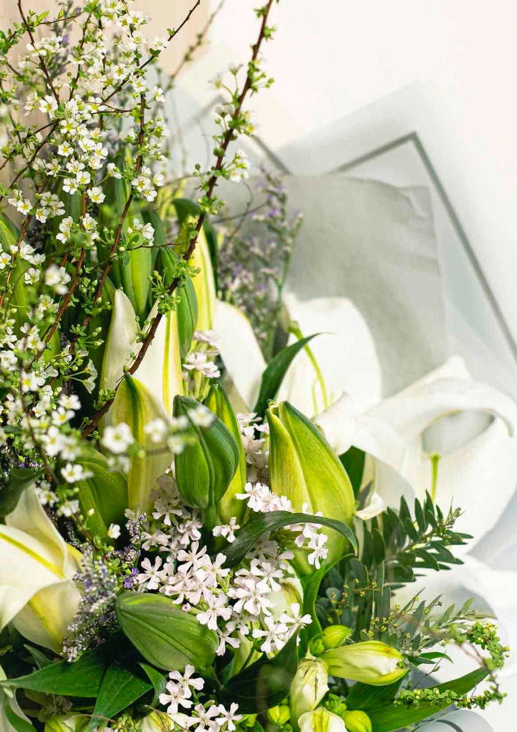 White lilies symbolise blissful weddings with a grand heart handpicked by top singapore florist for preserved flowers and customised flower arrangements and floral design