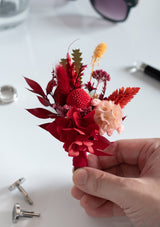 Groom's boutonniere in oriental red theme curated with preserved flowers by Singapore floral designer floral mikelle