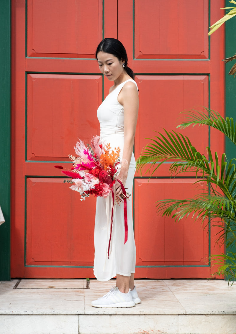 Oriental luxe red preserved bridal bouquet curated front facing by singapore florist