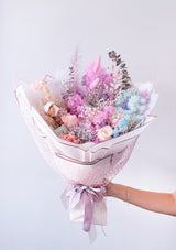 Medium sized pastel hues filled in a preserved flower bouquet specially designed by top preserved flower arrangement florist floral mikelle