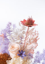 Featuring a peach stella luna flower and wood flowers in a vase arrangement designed by singapore floral mikelle