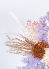 Designed by singapore florist floral mikelle dried banksia paired with complementing pastel hues of preserved flowers in a wooden vase