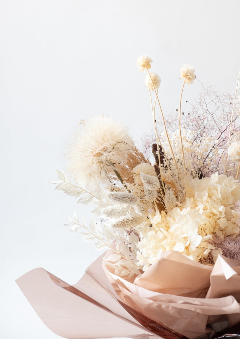 Plenty of strength and power is this preserved dandelion flower bouquet designed by singapore florist floral mikelle
