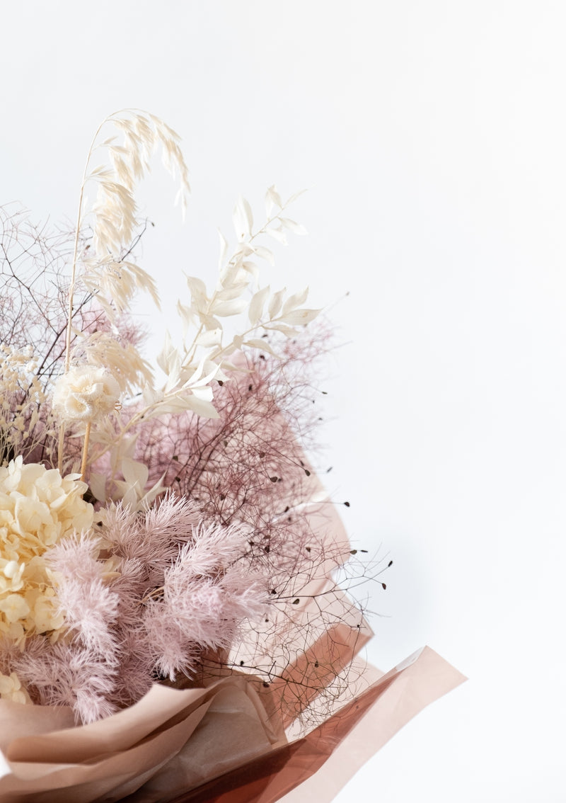 Preserved dandelion and dried blooms in a bouquet designed by singapore florist floral mikelle