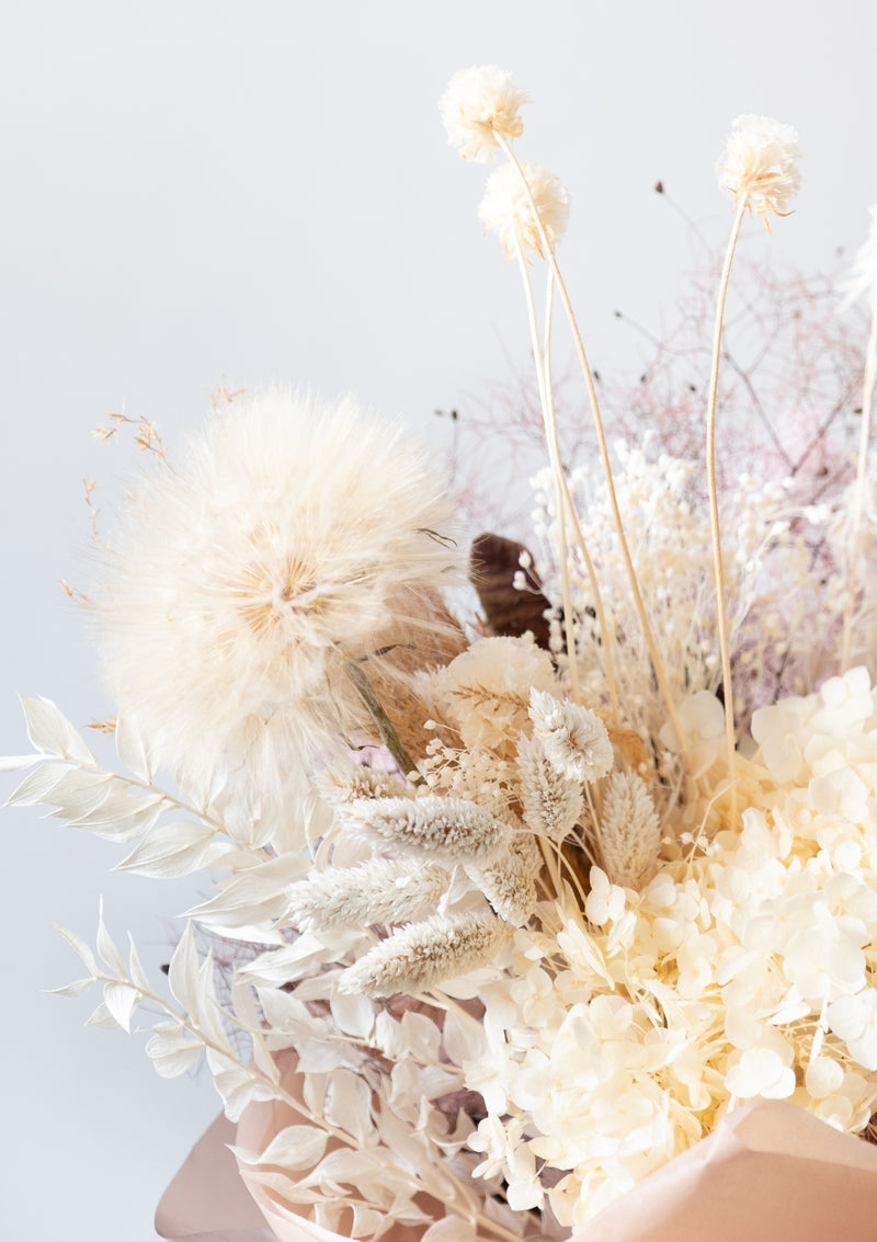Beautiful hand-tied bouquet of preserved dandelion hand-tied elegantly by bespoke florist floral mikelle