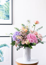 Grand and tall flower arrangement in a marble vase curated by best mothers day flowers florist floral mikelle with free delivery in singapore