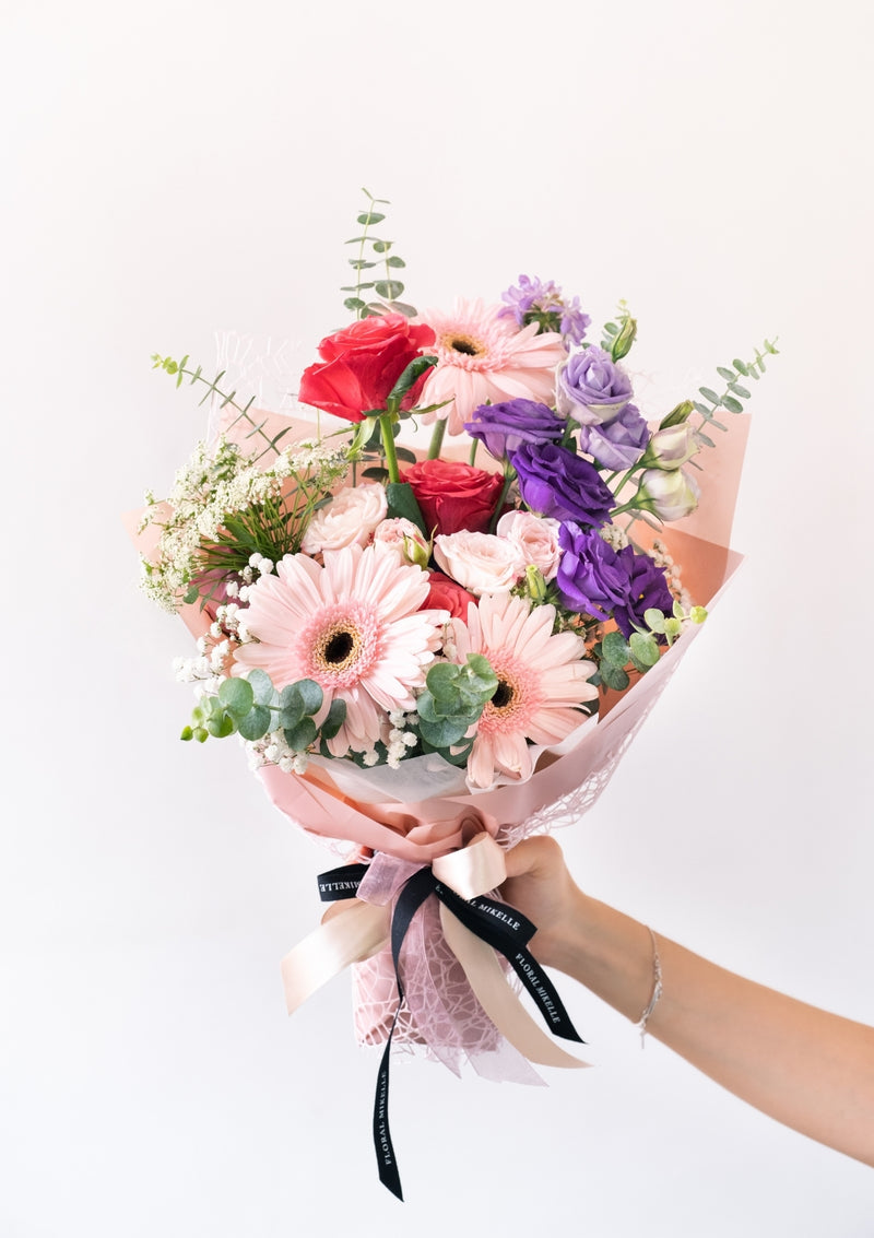 Pink purple fresh flower bouquet filled of seasonal handpick flowers to convey love and happiness