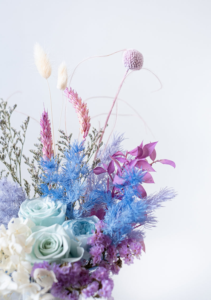 Inspired of the deep blues and gorgeous colors beneath the waves, a magical preserved flower arrangement designed by singapore best florist floral mikelle