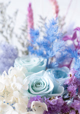 Amazing tiffany blue roses preserved flower arrangement in a vase with accompanying mermaid colors inspired of the sea corals in singapore with free delivery