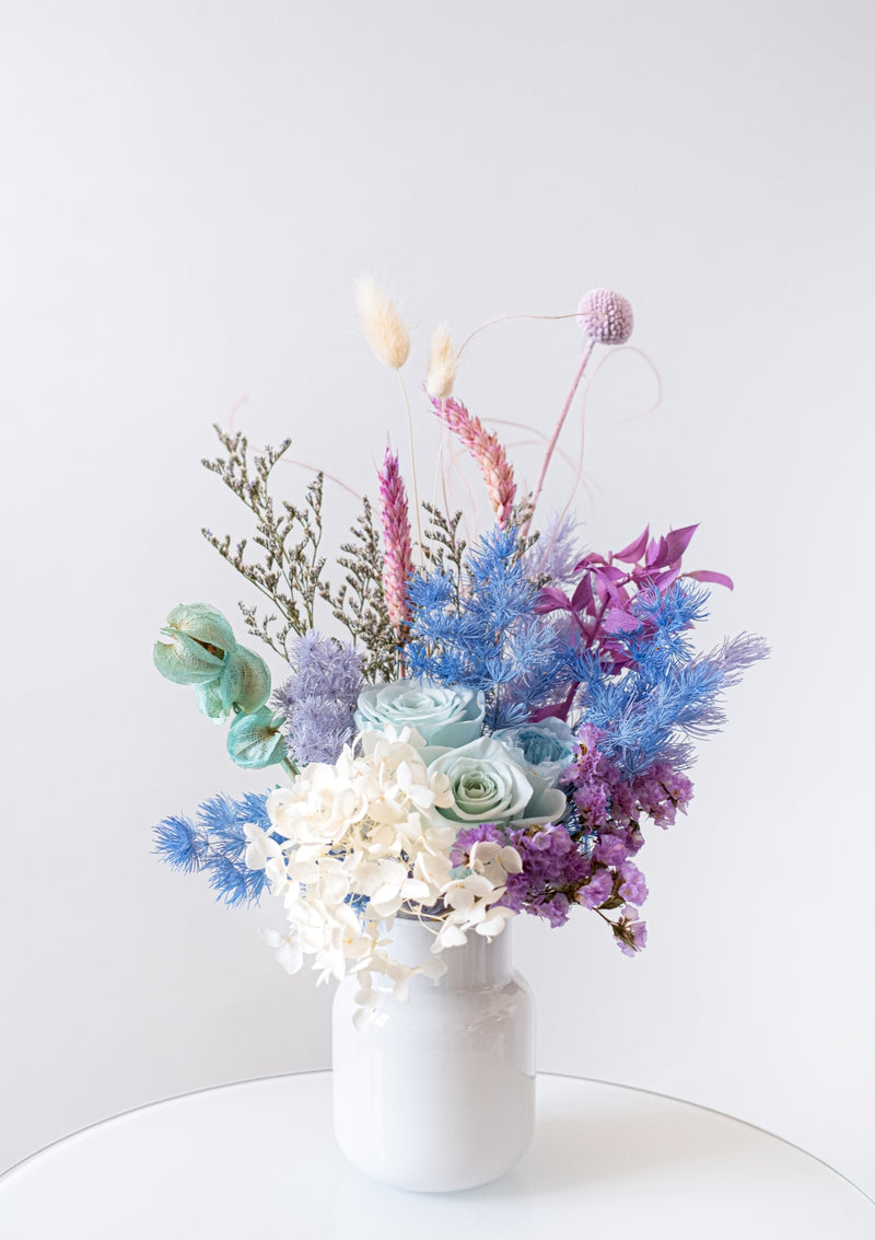 Colors of a mermaid in a flower vase arrangement filled of whimsical and quaint vibes the best cheer to send along to a friend and love one with free delivery in singapore
