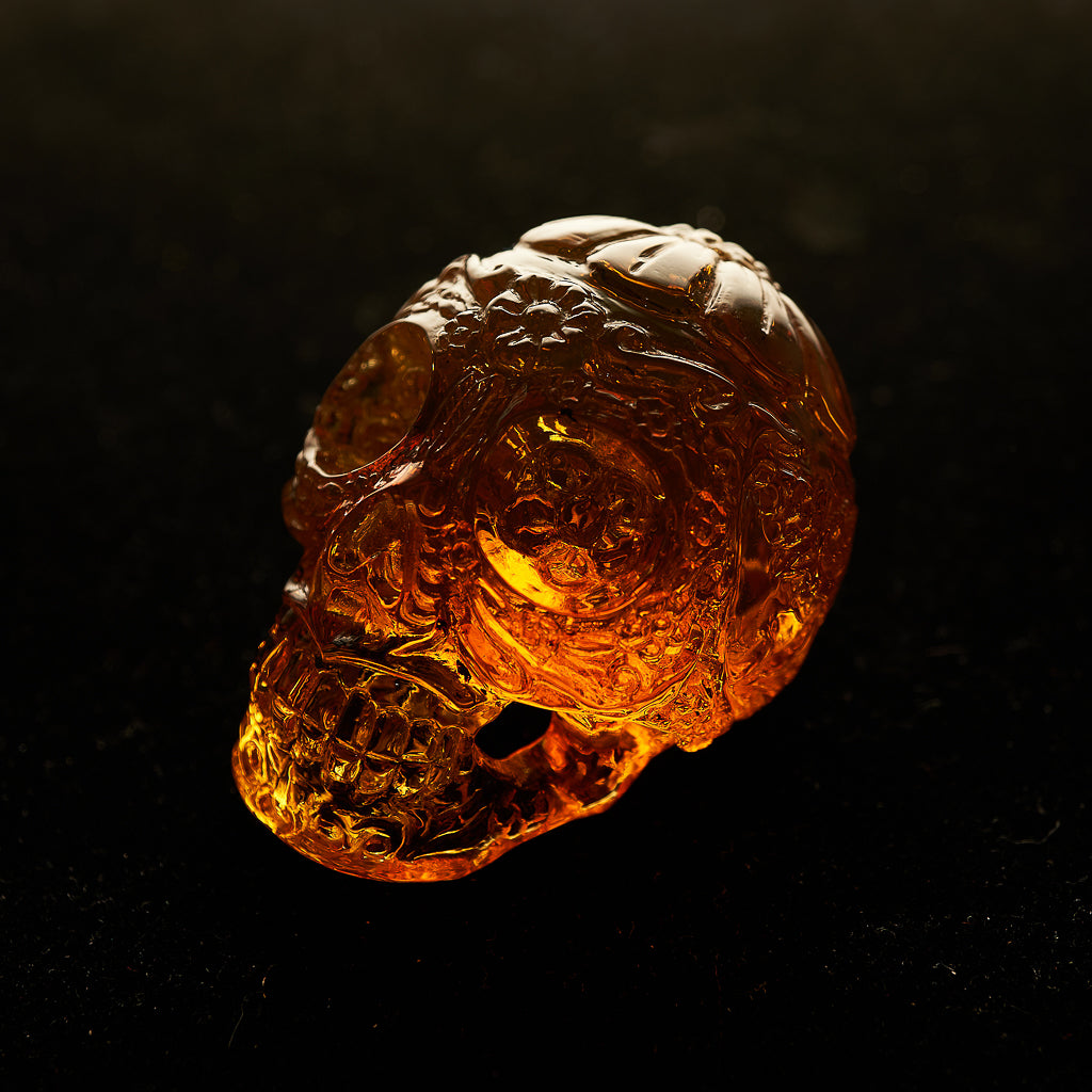 Dominican Green Amber Skull Carving