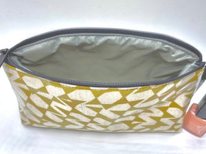 Makeup Bag in Gold Streamers