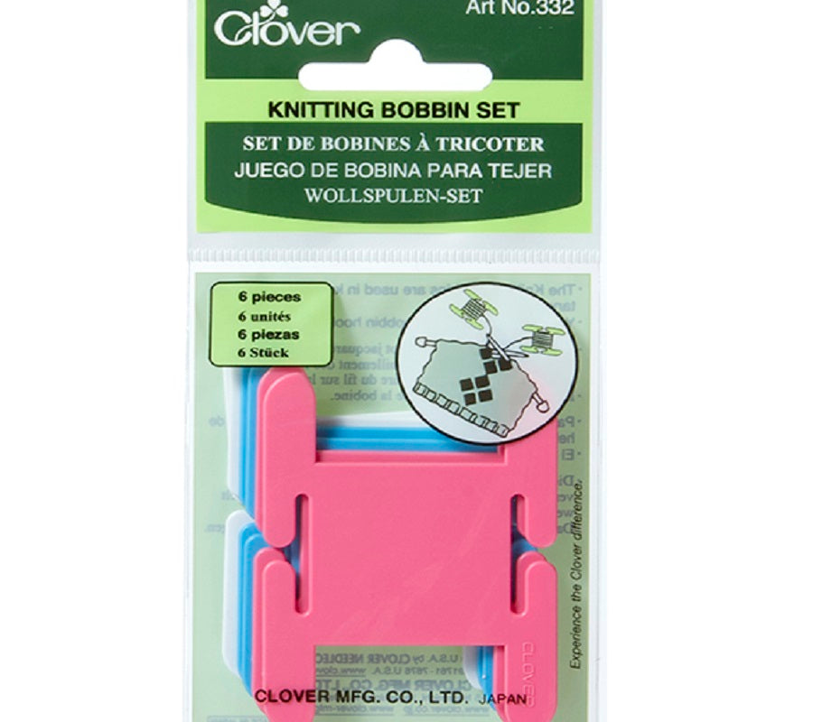 A package of a Clover Knitting Bobbin Set in pink, blue and white