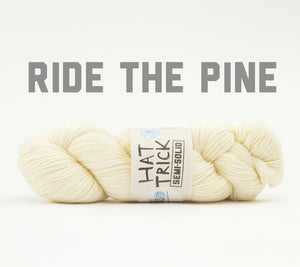 A skein of RCY Hat Trick Semi-Solid in Ride The Pine