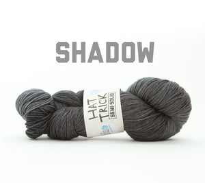 A skein of RCY Hat Trick Semi-Solid in Shadow