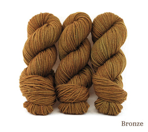 Three skeins of Ancient Arts Lascaux Worsted in Bronze