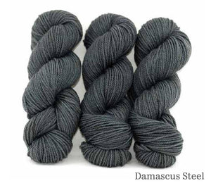 Three skeins of Ancient Arts Lascaux Worsted in Damascus Steel
