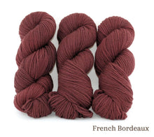 Load image into Gallery viewer, Three skeins of Ancient Arts Lascaux Worsted in French Bordeaux