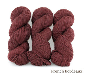 Three skeins of Ancient Arts Lascaux Worsted in French Bordeaux